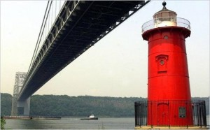 Little Red Lighthouse under big grey bridge